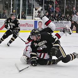 COBOURG,ON - Nov 5 : Ontario Junior Hockey League Game Action Between Cobourg Cougars and Pickering Panthers, during second period game action Corey Helliwell #18 of the Cobourg Cougars makes the hit.(Photo by Dave Powers / OJHL Images)