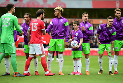 Matchday mascot walks out onto the pitch with Joe Bryan of Bristol City - Mandatory by-line: Alex James/JMP - 28/04/2018 - FOOTBALL - The City Ground - Nottingham, England - Nottingham Forest v Bristol City - Sky Bet Championship
