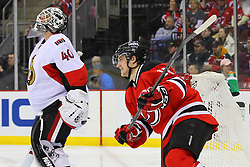 Dec 18, 2013; Newark, NJ, USA;  New Jersey Devils center Reid Boucher (15) skates past Ottawa Senators goalie Robin Lehner (40) during the second period at the Prudential Center.