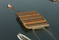 Aerial photographs of the Tugboat, Ranger (Crowley Maritime) pulling 17 barges through the New York Harbor<br /> 3/25/2009. Aerial view of Nautical Vessel