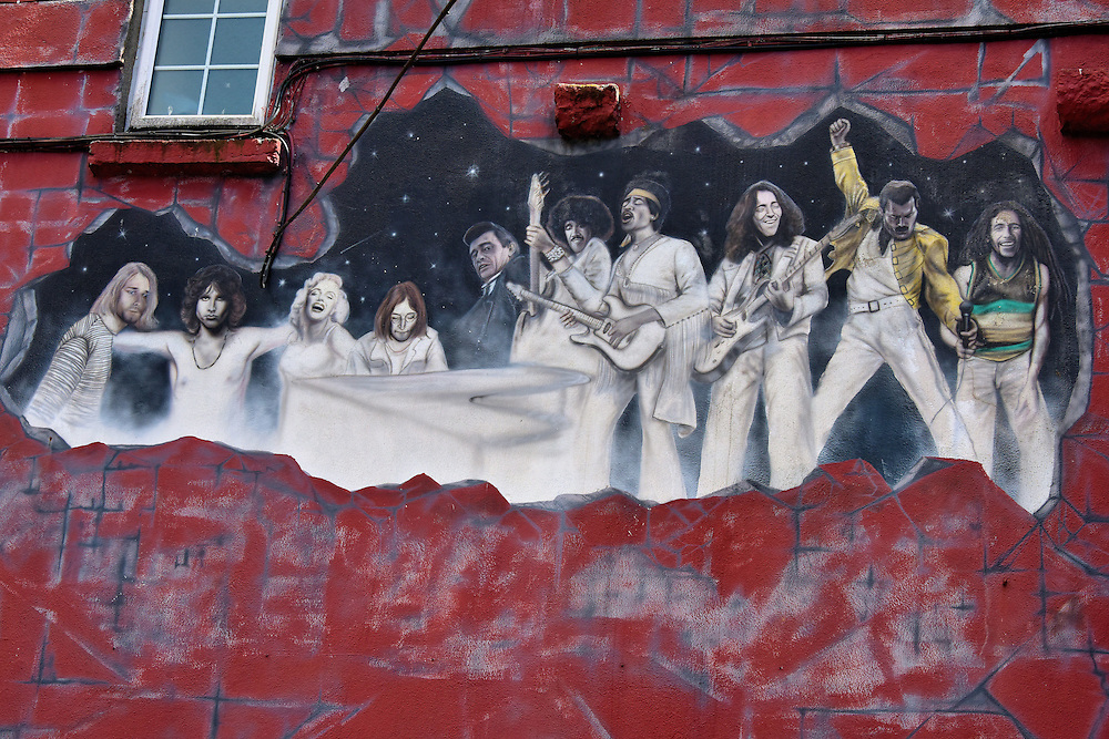 Tribute to Dead Entertainers Mural in Galway, Ireland<br /> This ensemble of entertainers who all died prematurely is part of a three-story mural on the side of Sally Longs Rock Bar at Abbeygate Street.  Commissioned by Noel O&rsquo;Dwyer and painted in 2007 by Ciar&aacute;n Dunlevy, it was the young muralist&rsquo;s first public artwork.  Featured among the legends are Kurt Cobain, Jim Morrison, Marilyn Monroe, John Lennon, Johnny Cash, Jimi Hendrix and Bob Marley.