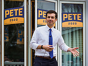 "17 APRIL 2019 - MARSHALLTOWN, IOWA:  Mayor PETE BUTTIGIEG talks to voters during a meet and greet at home in Marshalltown, Iowa. People came from as far away as Minneapolis, Minnesota and Rockford, Illinois to meet the mayor of South Bend, Indiana. ""Mayor Pete,"" as he goes by, declared his candidacy to be the Democratic nominee for the US Presidency on April 14. Buttigieg is touring Iowa this week. Iowa traditionally hosts the the first selection event of the presidential election cycle. The Iowa Caucuses will be on Feb. 3, 2020.              PHOTO BY JACK KURTZ"
