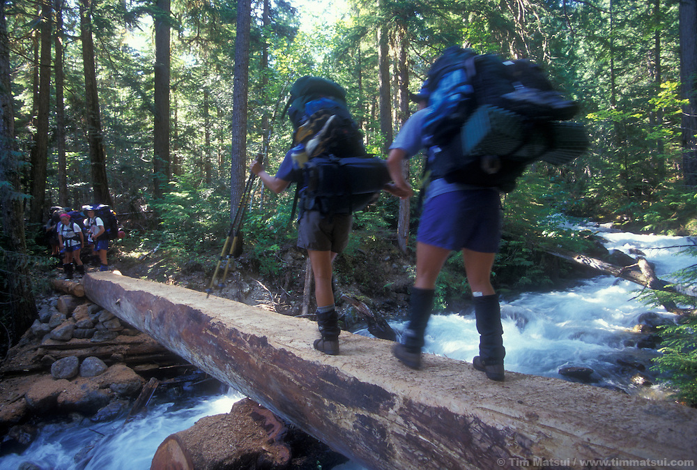 Backpackers cross the Big Beaver River deep in the North Cascades National Park.