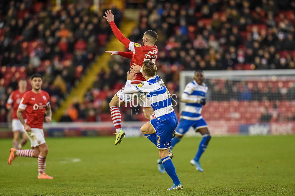 Conor Chaplin of Barnsley FC and Todd Kane of Queens Park Rangers compete for the ball during the EFL Sky Bet Championship match between Barnsley and Queens Park Rangers at Oakwell, Barnsley, England on 14 December 2019.