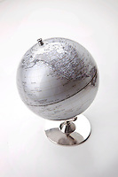 Close-up of silver globe over white background