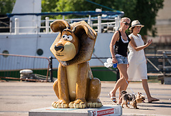 "© Licensed to London News Pictures.  02/07/2018; Bristol, UK. Gromit Unleashed 2. ""Alex the Lion"" Gromit character installed at M Shed square for the Gromit Unleashed 2 sculpture trail. Gromit Unleashed 2, which officially begins today on 02 July, will see the Academy Award®-winning character Gromit by Nick Park at Aardman Animations returning to Bristol in 2018 for the second time on sculpture trails to raise money for  the Grand Appeal charity. The character of Gromit will be joined by Wallace and their arch nemesis Feathers McGraw. The trail will feature over 60 giant sculptures designed by high-profile artists, designers, innovators and local talent. Sculptures will be positioned in high footfall and iconic locations around Bristol and the surrounding area. Photo credit: Simon Chapman/LNP"
