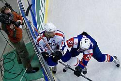Andrej Hebar of Slovenia vs Veljko Zibret of Croatia at IIHF Ice-hockey World Championships Division I Group B match between National teams of Slovenia and Croatia, on April 18, 2010, in Tivoli hall, Ljubljana, Slovenia. (Photo by Matic Klansek Velej / Sportida)