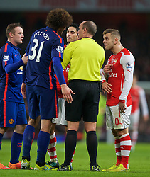 LONDON, ENGLAND - Saturday, November 22, 2014: Arsenal's Jack Wilshere and Manchester United's Marouane Fellaini are spoken to by referee Mike Dean during the Premier League match at the Emirates Stadium. (Pic by David Rawcliffe/Propaganda)