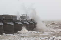 © Licensed to London News Pictures. 06/12/2015. Brighton, UK. Powerful waves are hitting the Marina wall in Brighton as the South Coast gets some of the fallout of storm Desmond. Today December 6th 2015. Photo credit: Hugo Michiels/LNP