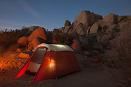 Tent at dusk at campsite in Joshua Tree National Park, California. http://www.gettyimages.com/detail/photo/be-adventurous-royalty-free-image/486965909