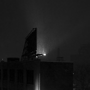 Billboard in the DUMBO section of Brooklyn during a heavy snowstorm at night.