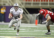 Xavier tailback Pat Chizek (23) runs around City High tackle Adam Prybil (36) in their Class 4A semifinal game at the UNI Dome in Cedar Falls on Friday November 13, 2009.