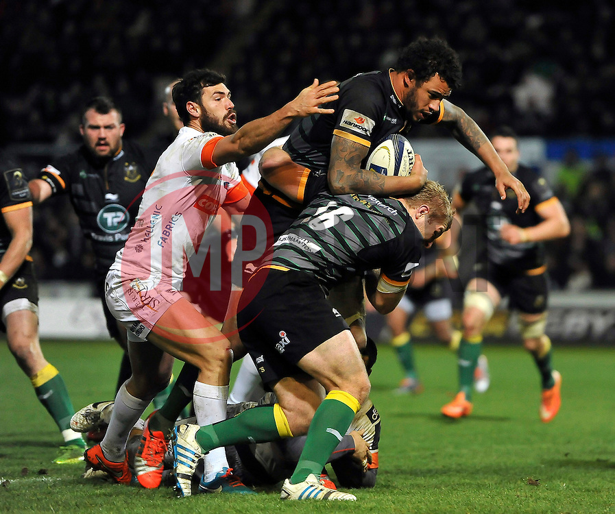 Courtney Lawes of Northampton Saints takes on the Treviso defence - Photo mandatory by-line: Patrick Khachfe/JMP - Mobile: 07966 386802 13/12/2014 - SPORT - RUGBY UNION - Northampton - Franklin's Gardens - Northampton Saints v Treviso - European Rugby Champions Cup