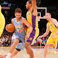 06 October 2013: Denver Nuggets shooting guard Evan Fournier (94) drives past Los Angeles Lakers shooting guard Xavier Henry (7) during the Denver Nuggets 97-88 victory over the Los Angeles Lakers at the Staples Center, Los Angeles, California, USA.