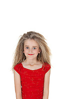 Portrait of happy girl in red outfit over white background