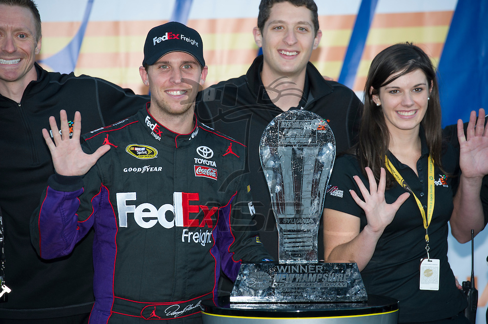 Loudon, NH - SEP 23, 2012:  Denny Hamlin (11) wins the Sylvania 300 at New Hampshire Motor Speedway in Loudon, NH.