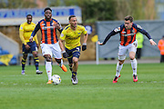 Oxford United's Kemar Roofe breaks with the ball during the Sky Bet League 2 match between Oxford United and Luton Town at the Kassam Stadium, Oxford, England on 16 April 2016. Photo by Shane Healey.
