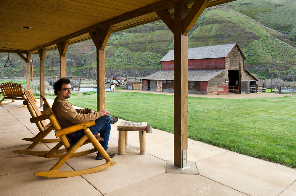 Man relaxing in rocking chair at Cottonwood Canyon State Park, Oregon