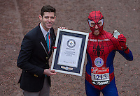 Paul Martelleti of Great Britain is given his certificate after becoming the new Guinness World Record holder for the fastest marathon dressed as Spiderman at the Virgin Money  London Marathon , Sunday 26th April 2015.<br /> <br /> Dillon Bryden for Virgin Money London Marathon<br /> <br /> For more information please contact Penny Dain at pennyd@london-marathon.co.uk