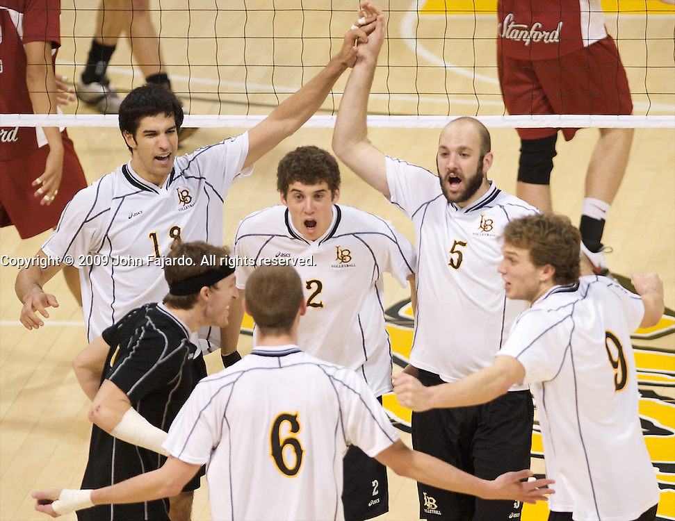 The 49ers celebrate the point in the Mountain Pacific Sports Federation match against Stanford at the Walter Pyramid, Long Beach CA, Friday April 3, 2009.  Long Beach State loses the match in five sets 30-28, 18-30, 26-30, 30-26, 18-20.