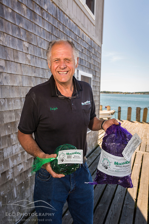 Owner Ralph Smith holds processed bags of mussels outside Moosabec Mussels, Inc., in Jonesport, Maine.