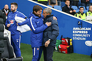 Chelsea Manager Antonio Conte meets Brighton and Hove Albion manager Chris Hughton during the Premier League match between Brighton and Hove Albion and Chelsea at the American Express Community Stadium, Brighton and Hove, England on 20 January 2018. Photo by Phil Duncan.