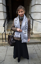 © London News Pictures. 02/11/2012. London, UK.  Marina Litvinenko, the wife of  former KGB agent Alexander Litvinenko posing for the camera as she leaves  Camden Town Hall in London following a pre inquest hearing in to the death of her husband in 2006. Mr Litvinenko, 43, an ex-KGB agent  who fled to Britain in 2000, was allegedly  poisoned by radioactive polonium-210  while drinking tea during a meeting with former security colleagues at the Millennium Hotel in London in 2006. Photo credit: Ben Cawthra/LNP.