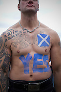 A bare-chested man with slogans painted on his torso listening to speeches on Calton Hill in Edinburgh, during a pro-Independence march and rally in the Scottish capital. The event, which was staged in support of the pro-Independence movement, was attended by an estimated by approximately 30,000 people. The referendum to decide whether Scotland will become an independent nation will be staged on 18th September 2014.