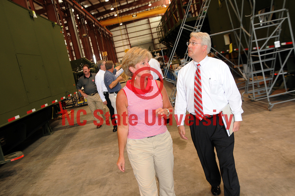 Chancellor Randy Woodson (right) looks around while being shown the work going on at TCOM by Lori Hassell, TCOM programs manager and NC State alumnus.
