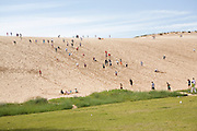 Oregon Marching Band members climb on dunes in Empire, Michigan on July 12, 2008.