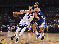 SHENZHEN, Oct. 5, 2017  Nemanja Bjelica (L) of Timberwolves breaks through during the NBA preseason basketball game between Golden State Warriors and Minnesota Timberwolves in Shenzhen City of south China's Guangdong Province, Oct. 5, 2017.  wll) (Credit Image: © Xia Yifang/Xinhua via ZUMA Wire)