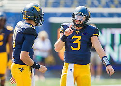 Sep 10, 2016; Morgantown, WV, USA; West Virginia Mountaineers quarterback Skyler Howard (3) talks with West Virginia Mountaineers quarterback Cody Saunders (10) before their game at Milan Puskar Stadium. Mandatory Credit: Ben Queen-USA TODAY Sports