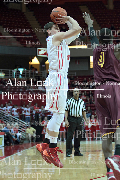11 January 2014:  Nick Zeisloft gets the angle for a quick three pointer over Devon Turk during an NCAA  mens basketball game between the Ramblers of Loyola University and the Illinois State Redbirds  in Redbird Arena, Normal IL.  Redbirds win 59-50