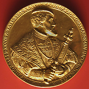 Charles V depicted on a gold coin. (Carlos I, Carlos V or 'Carlos I de España), 1500 – 1558)ruler of the Holy Roman Empire from 1519 and, as Carlos I of Spain, of the Spanish Empire from 1516 until his abdication in 1556.