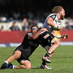 DURBAN, SOUTH AFRICA - MARCH 10: Willem Britz (captain) of the HITO-Communications Sunwolves tackled by John-Hubert Meyerof the Cell C Sharks during the Super Rugby match between Cell C Sharks and Sunwolves at Jonsson Kings Park Stadium on March 10, 2018 in Durban, South Africa. (Photo by Steve Haag/Gallo Images)