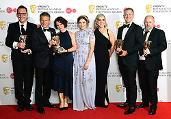 George Rainsford, Alicia Munroe, Oliver Kent and Mark Catley with their award for Best Soap and Continuing Drama in the press room at the Virgin TV British Academy Television Awards 2018 held at the Royal Festival Hall, Southbank Centre, London.