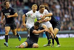 Chris Ashton (England) is double-tackled - Photo mandatory by-line: Patrick Khachfe/JMP - Tel: Mobile: 07966 386802 09/11/2013 - SPORT - RUGBY UNION -  Twickenham Stadium, London - England v Argentina - QBE Autumn Internationals.