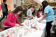 Nina McGarrahan decorates a cookie with members of Paint the World as part of a fundraising event for Shared Housing North Park Mall on Sunday, February 10, 2013 in Dallas, Texas. (Cooper Neill/The Dallas Morning News)