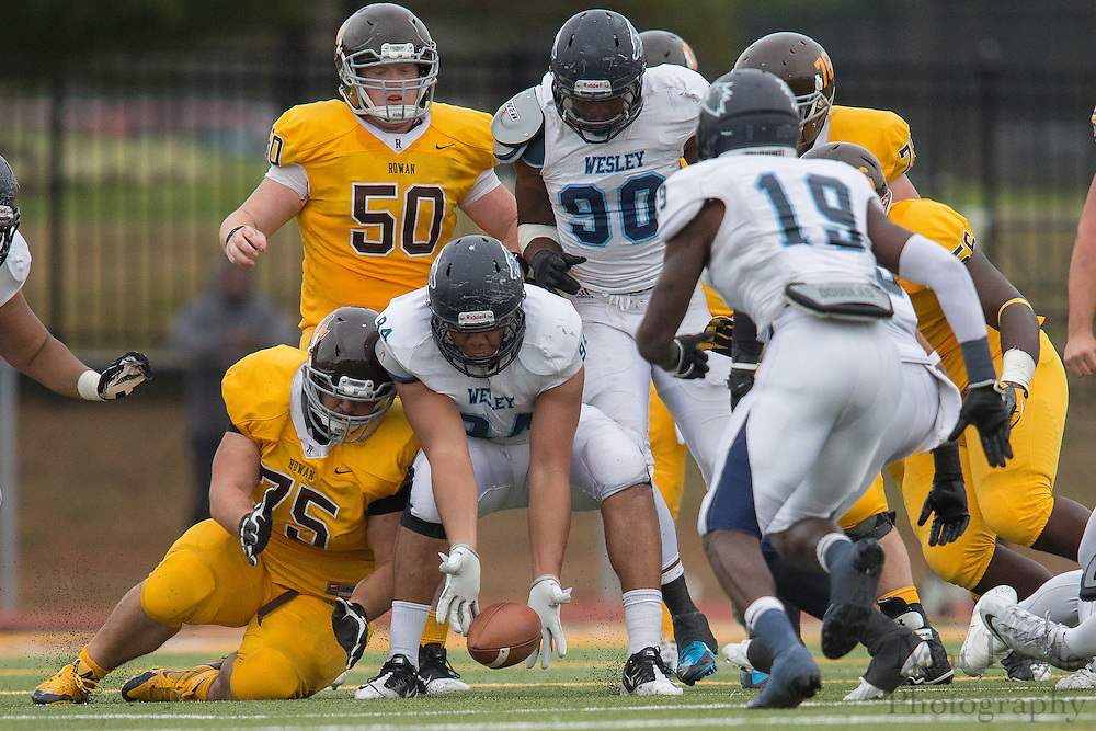 Wesley College Jr. DE Payton Rose (94), Rowan University Junior OL Joe Borden (75) - Rowan University Football vs Wesley College at Richard Wacker Stadium in Glassboro, NJ on Saturday October 19, 2013. (photo / Mat Boyle)