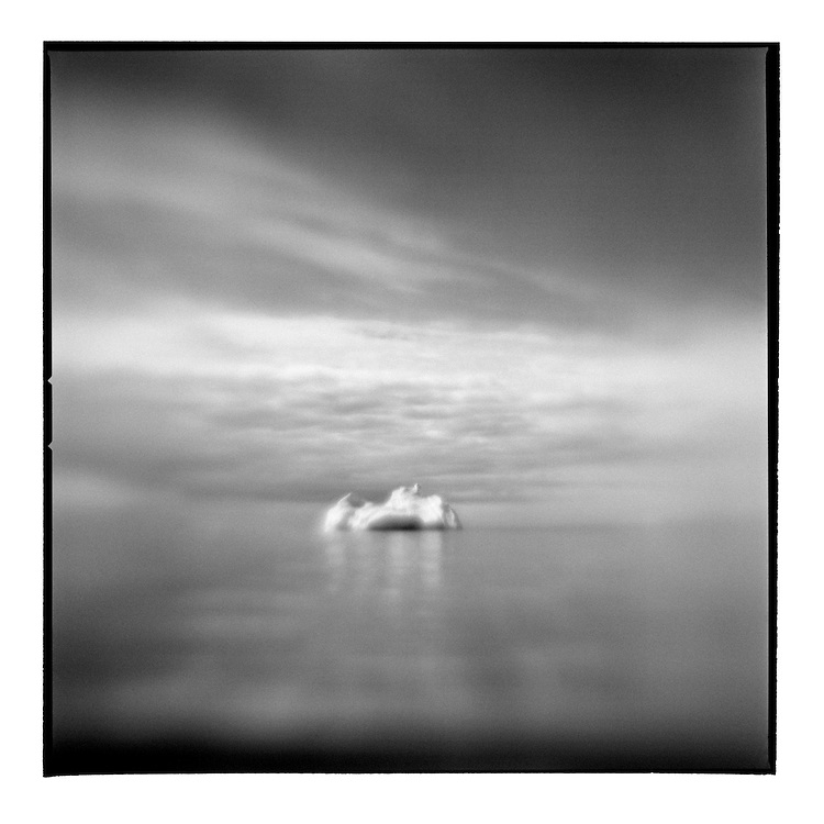 Greenland, Blurred black and white image of iceberg in Disko Bay in early summer