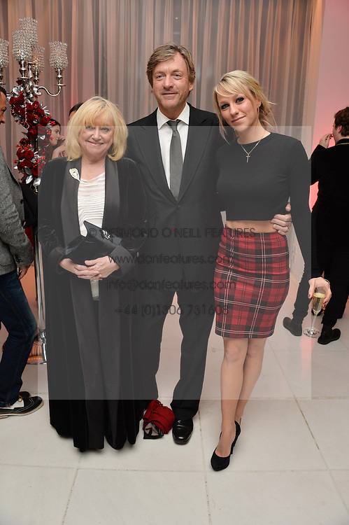 Left to right, JUDY FINNIGAN, RICHARD MADELEY and their daughter CHLOE MADELEY at a pre party for the English National Ballet's Christmas performance of The Nutcracker was held at the St.Martin's Lane Hotel, St.Martin's Lane, London on 12th December 2013.