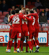 Matt Harrold of Crawley Town celebrates his goal with his teammates during the Sky Bet League 2 match between Crawley Town and Cambridge United at the Checkatrade.com Stadium, Crawley, England on 9 January 2016. Photo by Andy Walter.