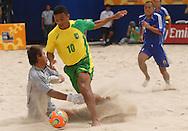 Football-FIFA Beach Soccer World Cup 2006 - Group A-BRA_JPN - Benjamin-BRA- defeats the japanese GK , Terukina-JPN-and scores the first of ten goals agaisnt Japan- Rio de Janeiro - Brazil 05/11/2006<br />Mandatory credit: FIFA/ Marco Antonio Rezende.