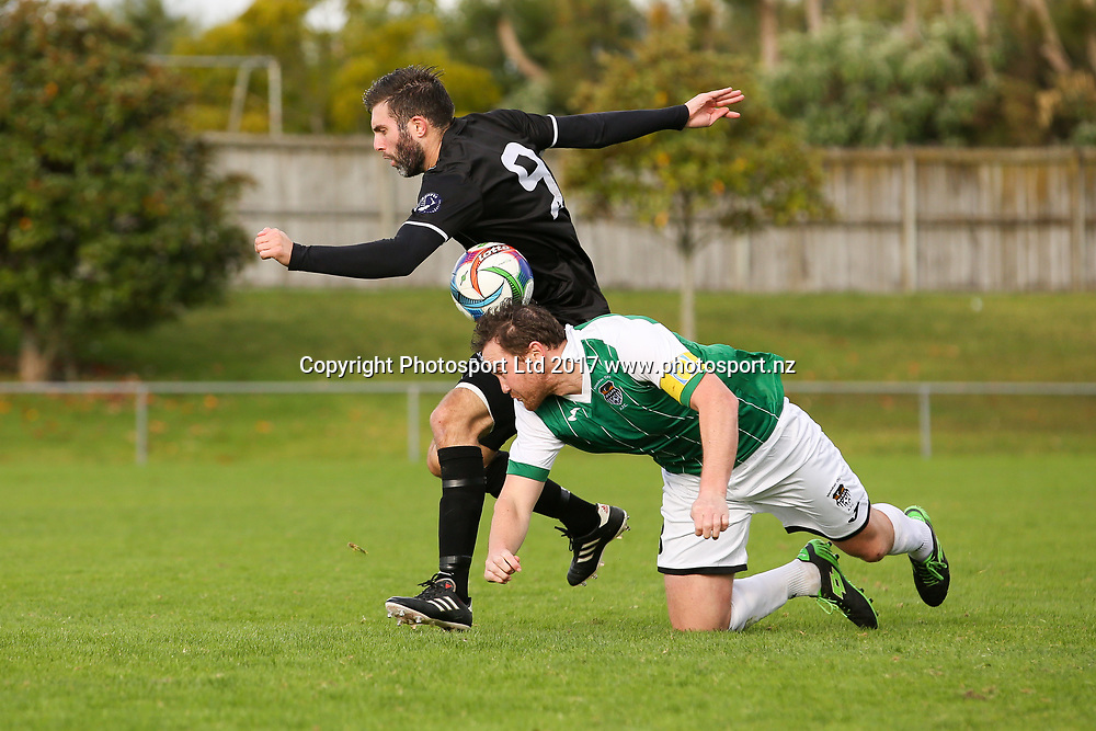 Manukau City's Hone Fowler and Waitakere City's Steve McDonald compete for the ball. ISPS Handa Chatham Cup Round 2, Waitakere City FC v Manukau City AFC, Fred Taylor Park, Whenuapai, Auckland, Monday 5th June 2017. Copyright Photo: David Joseph  / www.photosport.nz