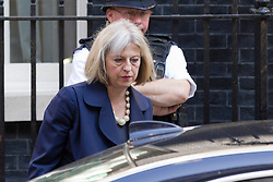 "© Licensed to London News Pictures. 29/08/2013. London, UK. Home Secretary Theresa May leaves a meeting of the British cabinet on Downing Street in London today (29/08/2013) as a recalled British Parliament prepares to debate the possibility of ""direct"" military action over recent reports an alleged chemical weapons attack in Syria. Photo credit: Matt Cetti-Roberts/LNP"