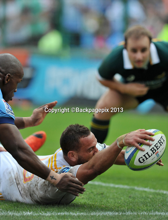 Aaron Cruden of the Chiefs score a try during the Super Rugby match between the Bulls and the Chiefs at Loftus Stadium in Pretoria on the 29 March 2014 ©Samuel Shivambu/BackpagePix