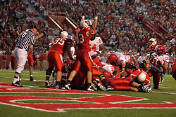 19 September 2009: A skirmish at the goal line eventually leads to a touchdown by Clifton Gordon of the Redbirds in a game which the Austin Peay Governors were defeated 38-7 by the Illinois State Redbirds at Hancock Stadium on campus of Illinois State University in Normal Illinois