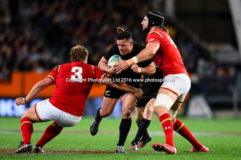 Ryan Crotty of the All Blacks is tackled by Tomas Francis of Wales and Luke Charteris of Wales during the 3rd Steinlager Series Rugby Union Test match, All Blacks v Wales, at Forsyth Barr Stadium, Dunedin, New Zealand. 25th June 2016. Copyright Photo: John Davidson / www.photosport.nz
