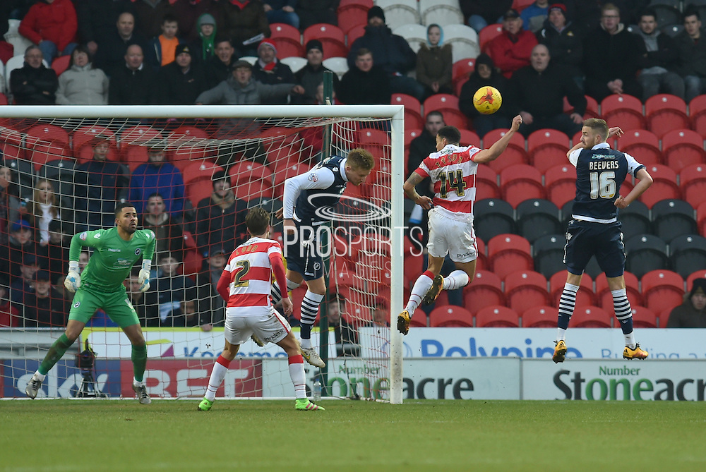Byron Webster of Millwall FC heads ball clear of goal area  during the Sky Bet League 1 match between Doncaster Rovers and Millwall at the Keepmoat Stadium, Doncaster, England on 27 February 2016. Photo by Ian Lyall.