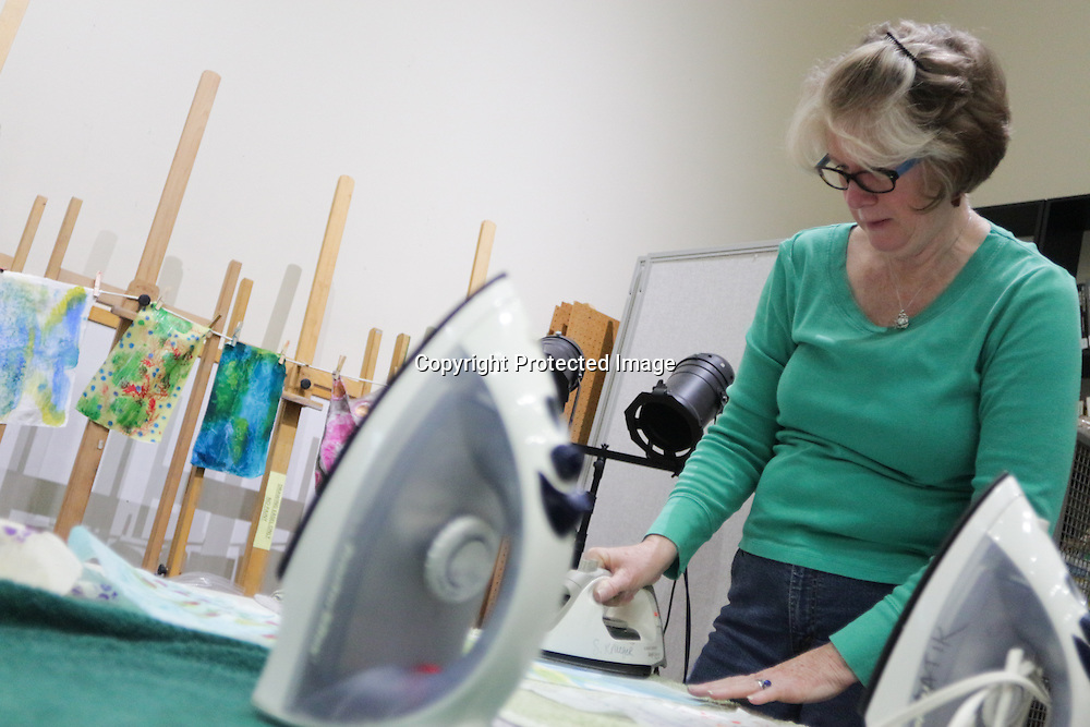 """Nancy Hawfield irons a quilt square during """"Create Your Own Quilt Squares"""" Sunday November 23, 2014 at the Cameron Art Museum in Wilmington, N.C. (Jason A. Frizzelle)"""